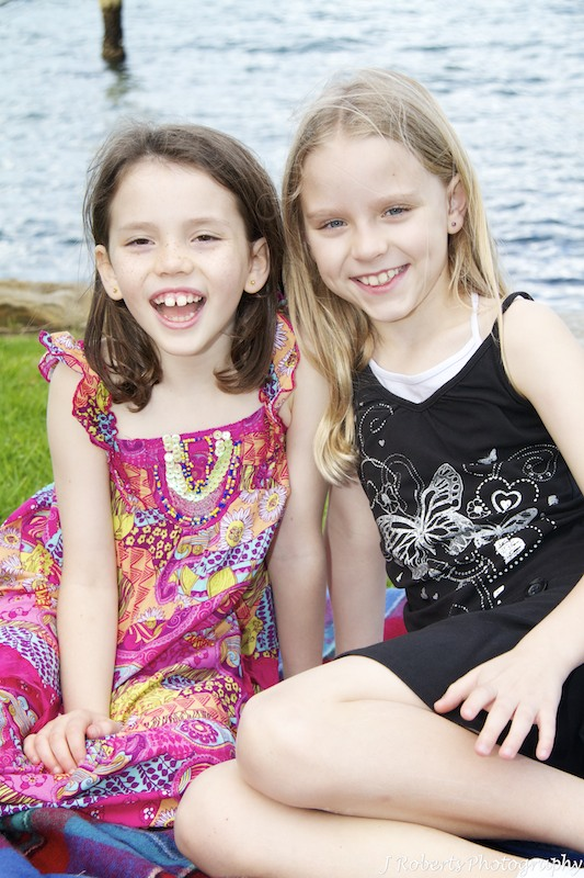 Sisters smiling - family portrait photography sydney