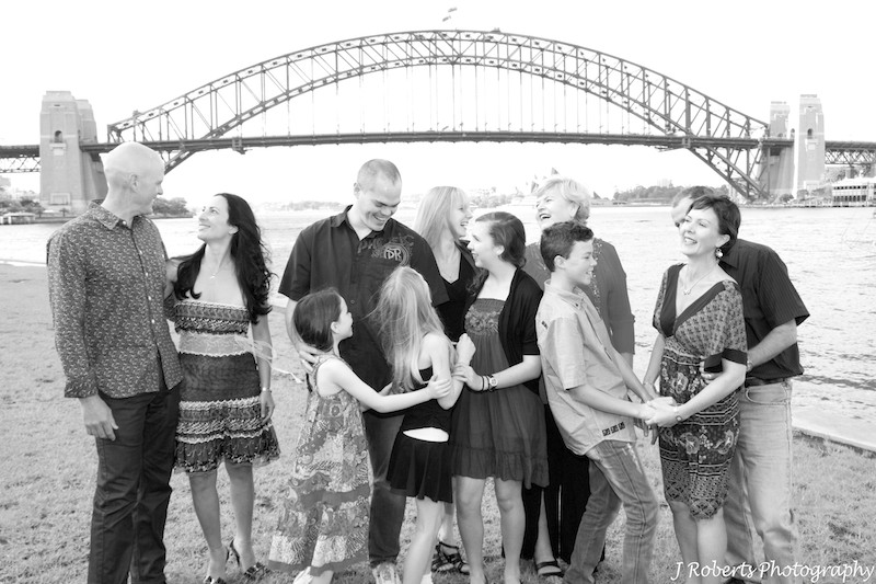 B&W extended family having fun - family portrait photography sydney