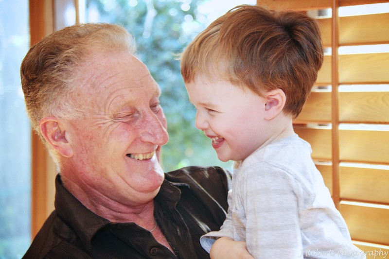 Grandad and grandson laughing together - family portrait photography sydney