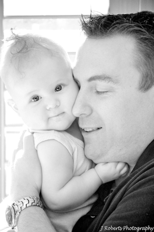 Dad having a cuddle with baby girl - family portrait photography sydney