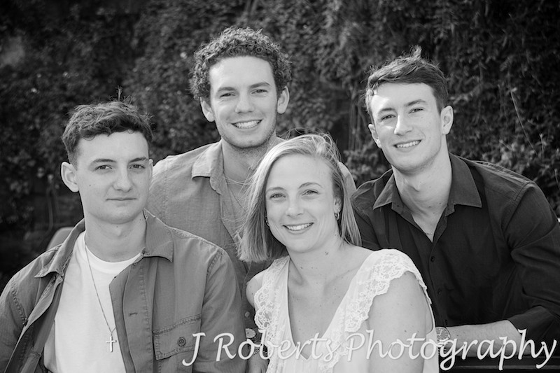4 siblings in family portrait. black and white - Family Portrait Photography Sydney