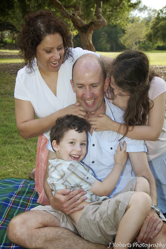 Family tickling father - family portrait photography