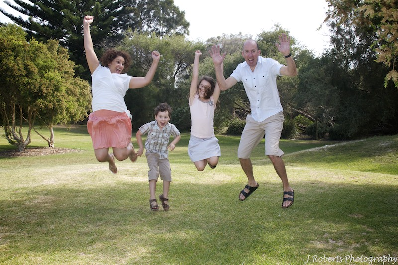 Jumping for joy - family portrait photography
