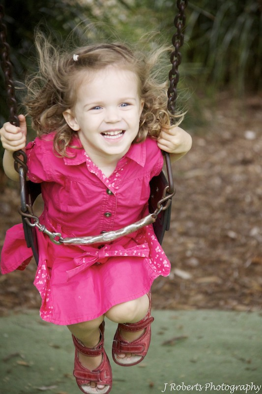 Toddler on the swings - family portrait photography sydney