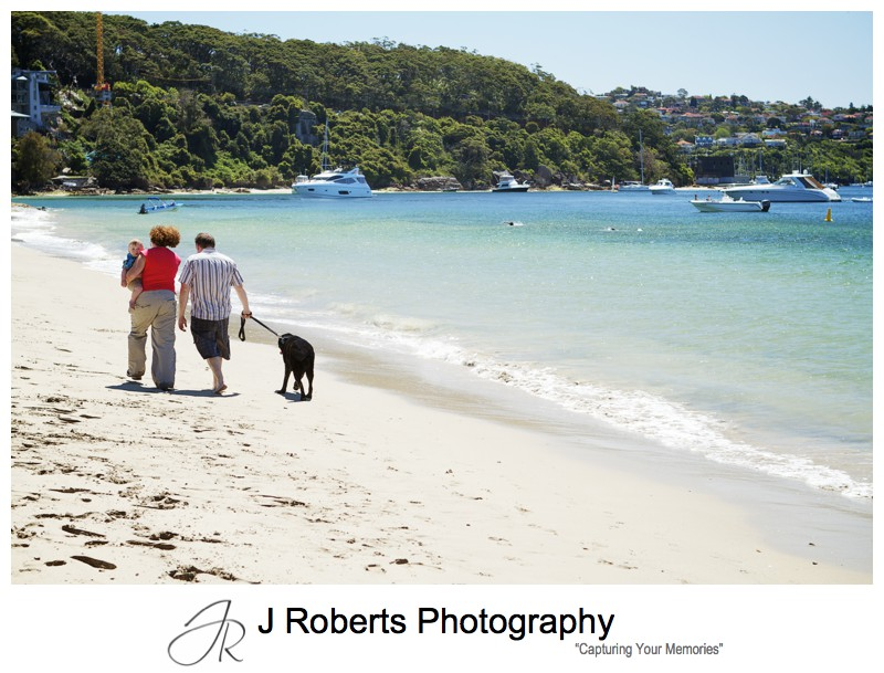 Family walking along the beach with their dog - sydney family portrait photographer