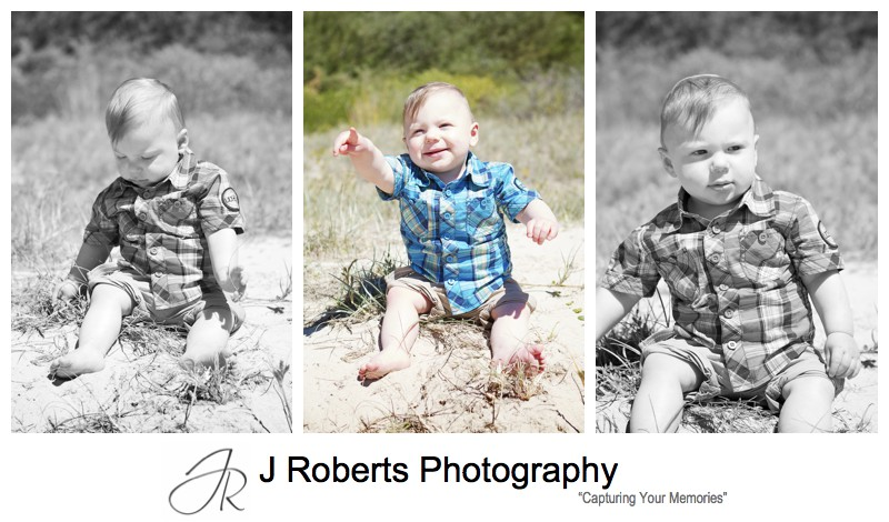 toddler sitting in sand dunes at the beach - sydney family portrait photographer