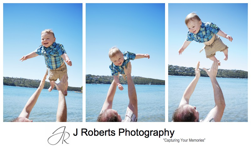 Dad throwing little boy in the air and laughing - sydney family portrait photographer