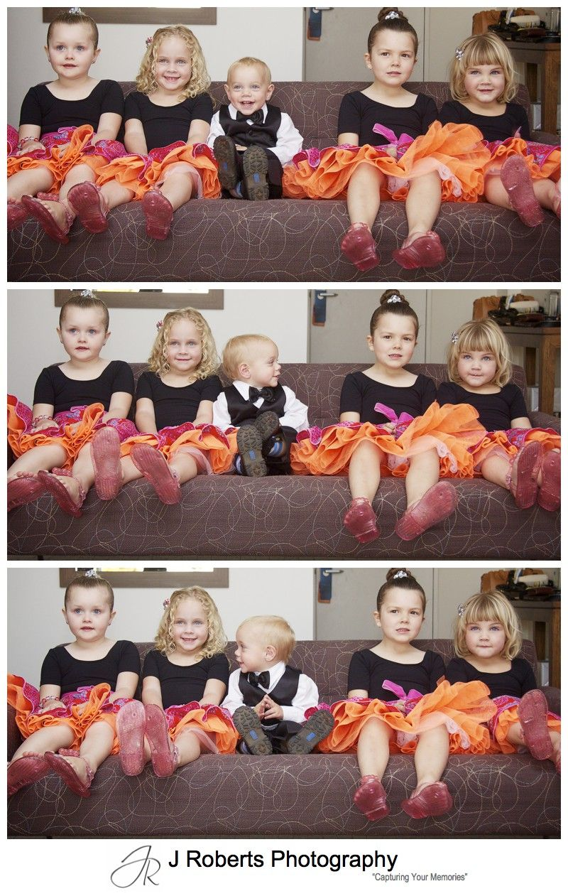 Flower girls and paige boy all lined up on a couch - sydney wedding photography with kids