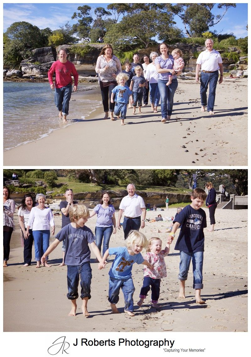 Extended family running along balmoral beach for a family portrait - family portrait photography sydney