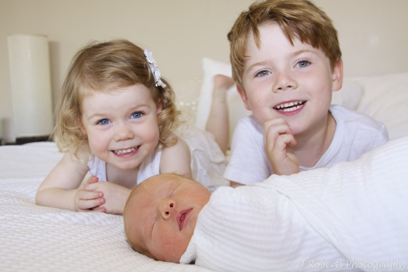 Siblings with newborn baby - newborn portrait photography