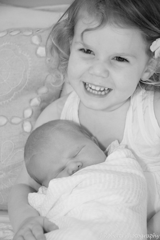 Big sister with baby - newborn portrait photography
