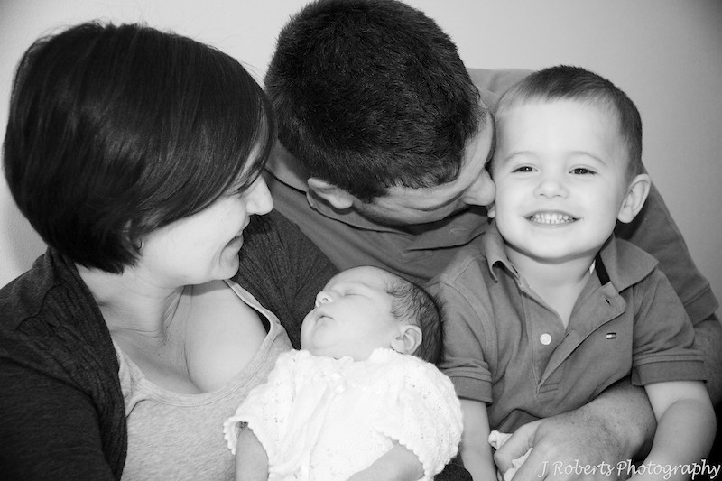 Family excited about a newborn baby - newborn baby portrait photography sydney