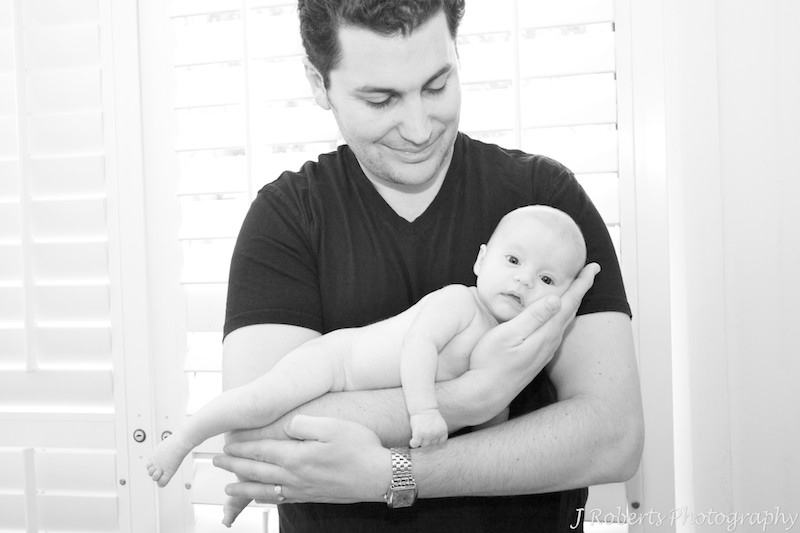 Baby girl in fathers arms - baby portrait photography sydney