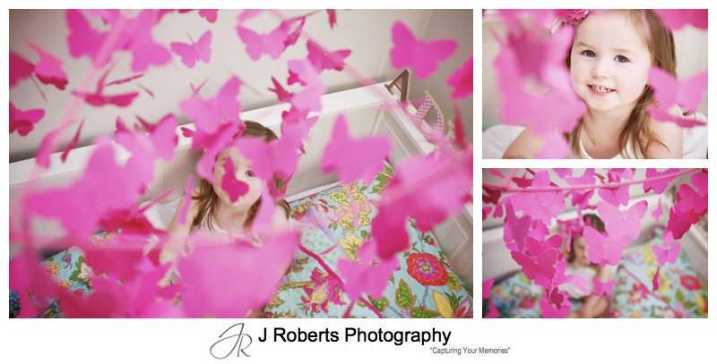 Little girl with pink butterfly mobile - family portrait photography sydney