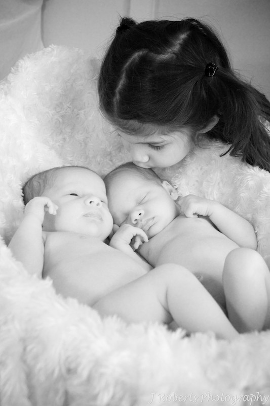 sister kissing twins in basket - baby portrait photography sydney