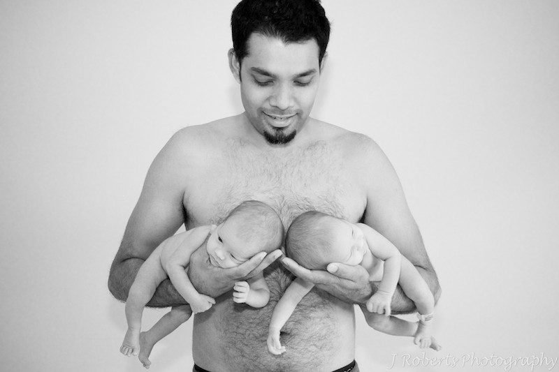B&W dad holding newborn baby twins - baby portrait photography sydney