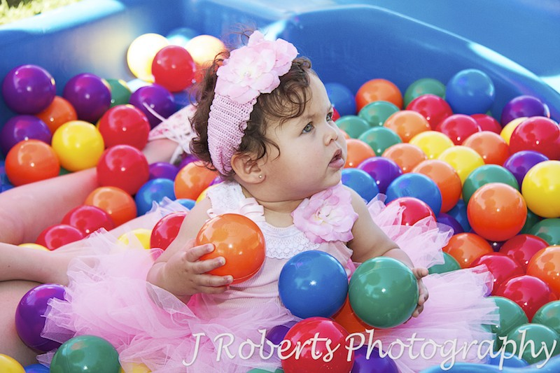 Birthday girl in the ballpit - Party Photography Sydney