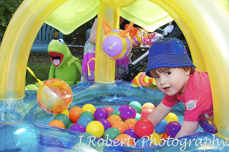 boy playing in ball-pit at birthday party - Party Photography Sydney