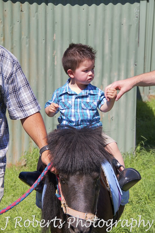 boy riding pony at birthday party - Party Photography Sydney