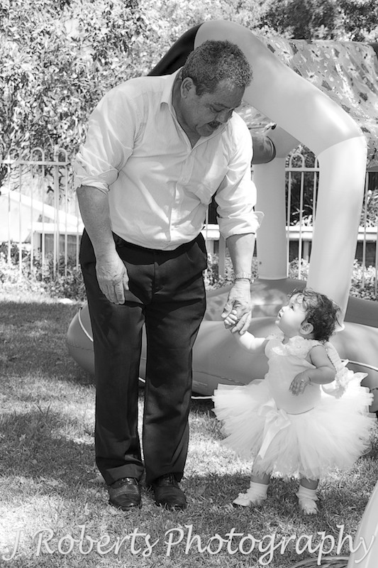Grandad and birthday girl walking - Party Photography Sydney