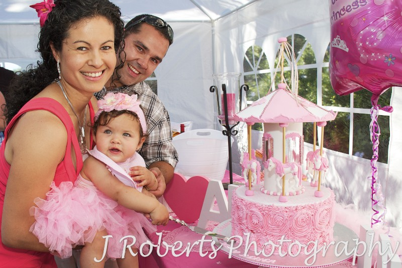 Birthday girl cutting the cake with mum and dad - Party Photography Sydney