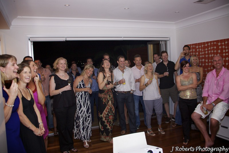 Laughing at speeches - party photography sydney