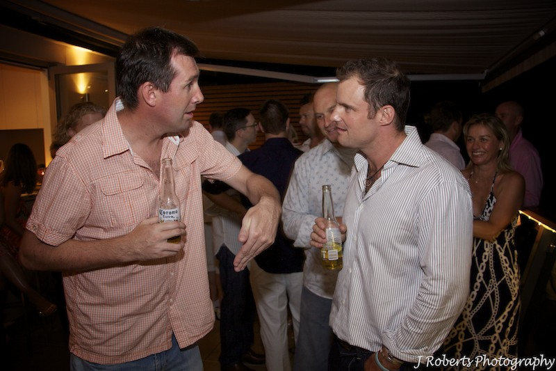 Giving instructions to Andrew Strauss - party photography sydney