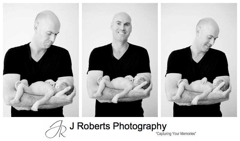 Proud daddy with newborn baby boy in his arms - newborn baby portrait photography sydney