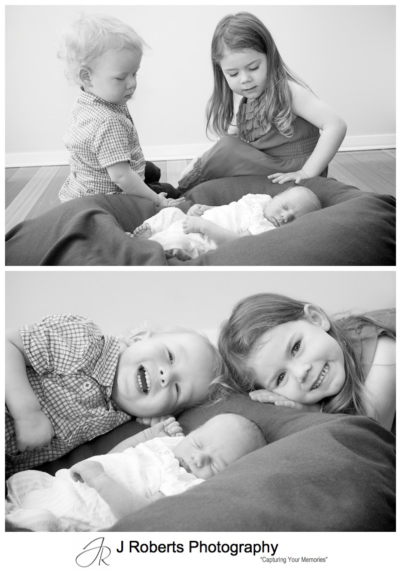 Older brother and sister looking after newborn baby boy - newborn baby portrait photography sydney