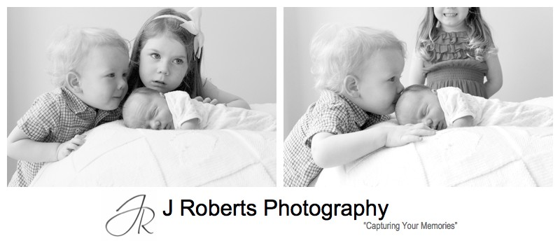 Toddler kissing his newborn brothers head- newborn baby portrait photography sydney