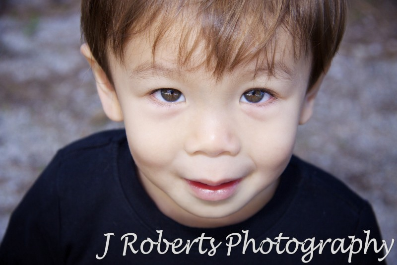 Toddler looking straight up at the camera with clear eyes - family portrait photography sydney