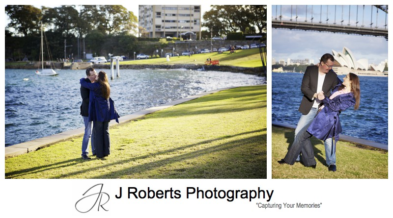 Couple dancing on the grass in front of sydney harbour at blues point reserve - pre wedding portraits sydney