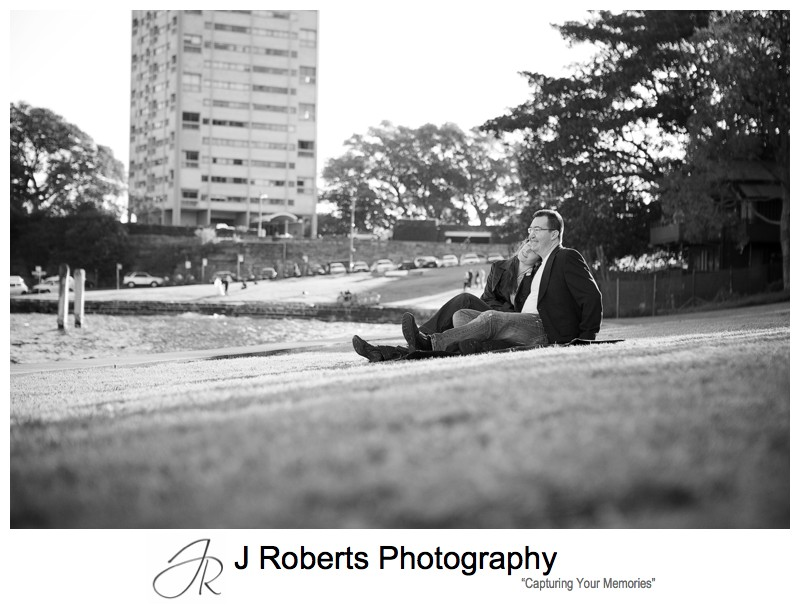 Couple sitting on rug at Blues Point Reserve - pre wedding portraits sydney