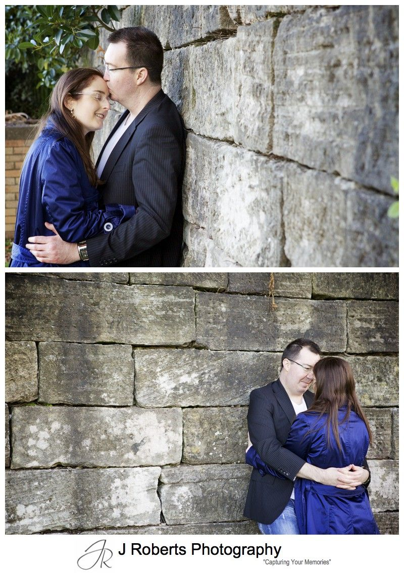 Portraits of an engaged couple with sandstone wall - engagement portraits sydney