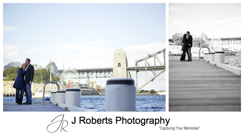Couple embracing on pier near Luna Park Sydney - pre wedding photography sydney