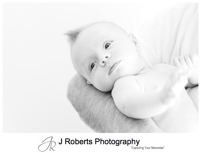 B&W portrait of a baby in her daddy's arms - sydney baby photographer