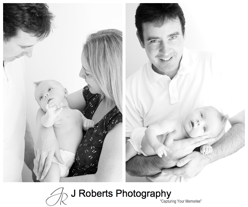 B&W portraits of a baby in her parents arms - sydney baby photographer