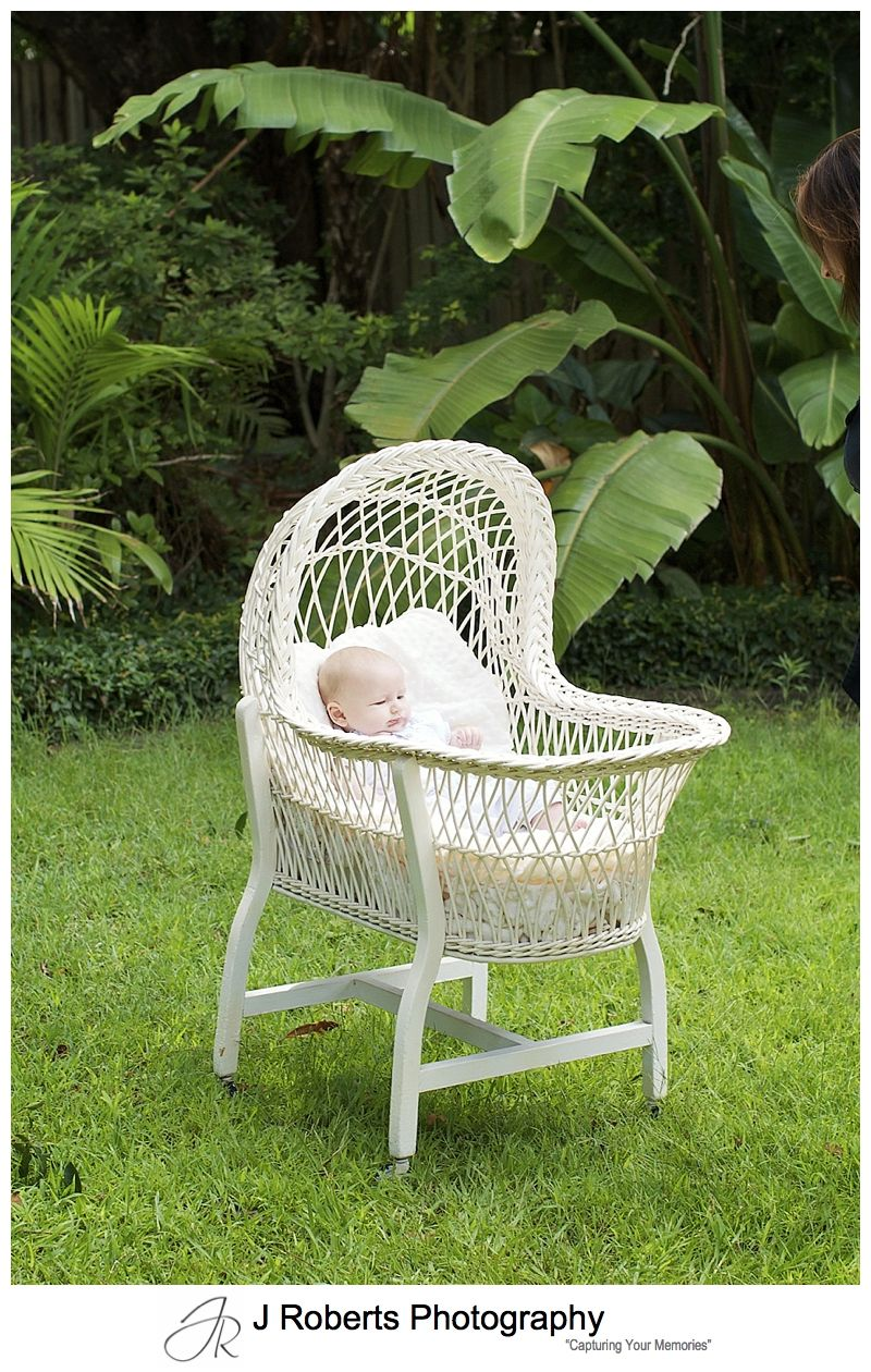 Baby boy in antique wicker basinet - sydney baby portrait photographer