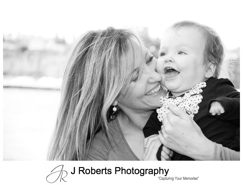 B&W portrait of mother and baby girl laughing - family portraits sydney