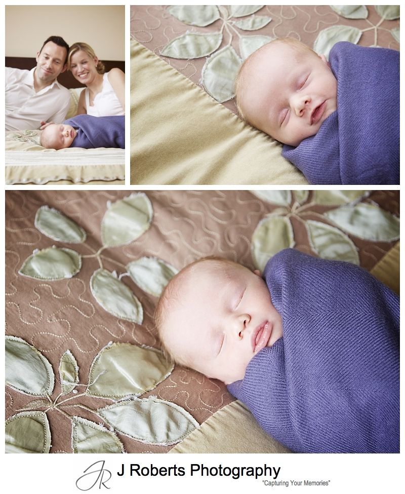 Baby wrapped and sleeping on parents bed - sydney baby portrait photographer