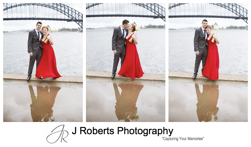 Couple reflected in rain puddle on sydney harbour - sydney wedding photography