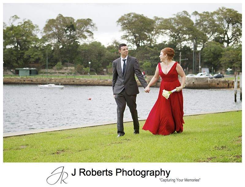 Couple walking along blues point reserve - sydney wedding photography