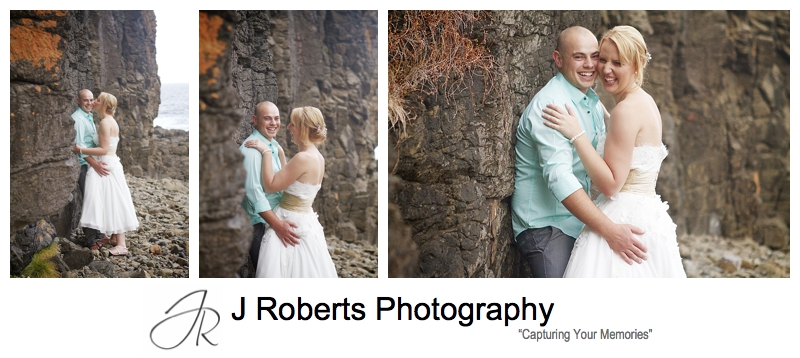 Laughing couple on the coastal cliff at Kiama - sydney wedding photographer