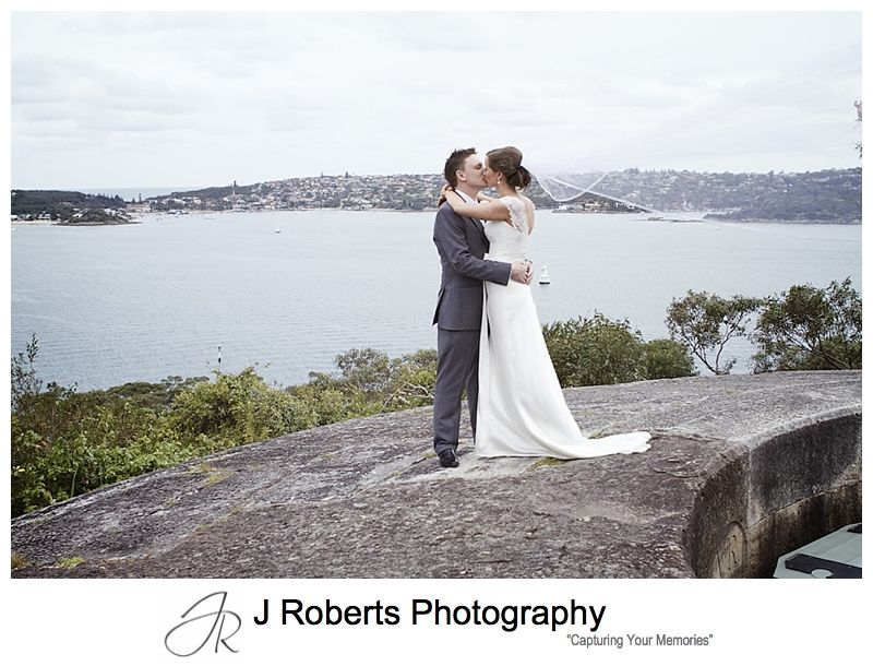 Couple kissing with flyaway veil at Georges Heights Mosman - sydney wedding photography