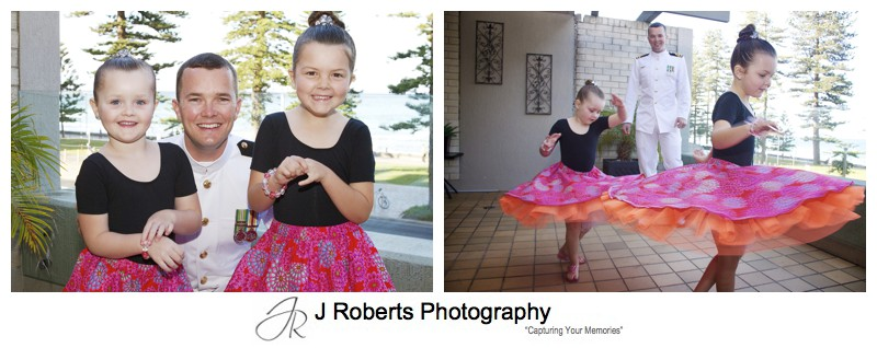 Groom with his 2 flower girls twirling in their dresses - sydney wedding photographer