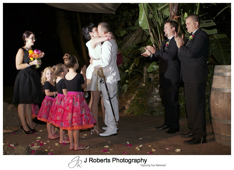 Couple first kiss in the courtyard at Le Kiosk Shelly Beach - sydney wedding photography
