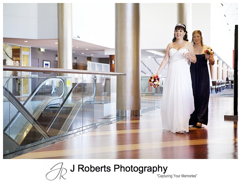 Bride departing for wedding from Novotel Darling Harbour - sydney wedding photography