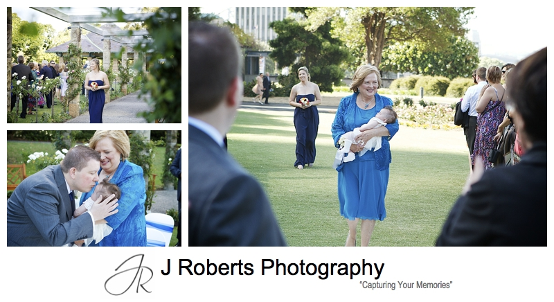 Mother of bride walking baby flower girl down the aisle - sydney wedding photography