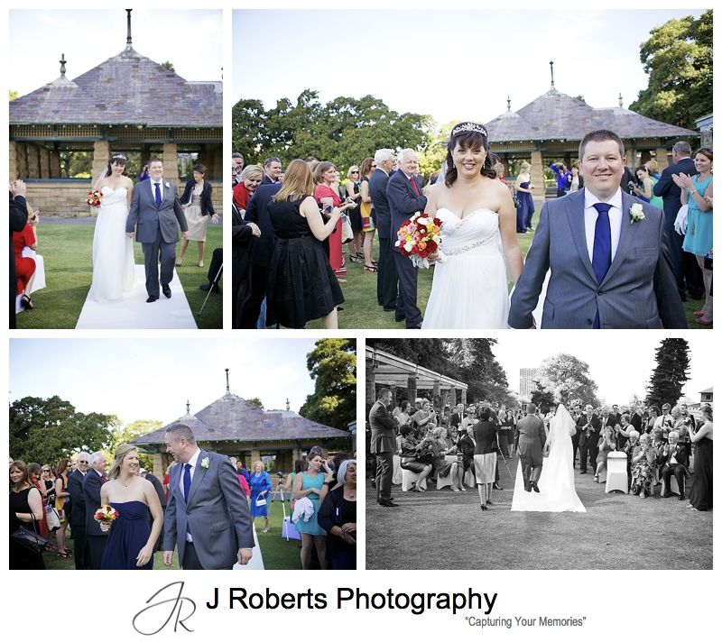 Very excited bride and groom walking down the aisle at the rose gardens - sydney wedding photography