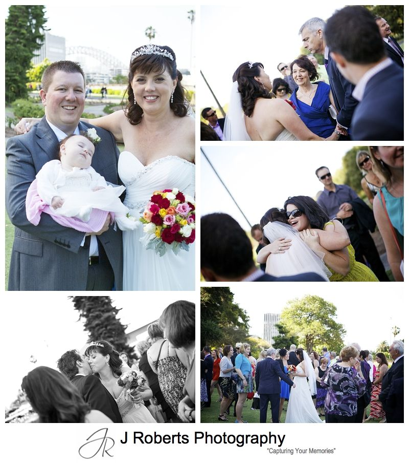 Portrait of the bride and groom with their baby flower girl - sydney wedding photography